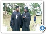 Archimandrite Mbonabingi Costantine with Vicar General Paul Mutaasa